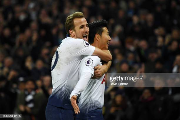 HeungMin Son of Tottenham Hotspur celebrates with teammate Harry Kane after scoring his team's third goal during the Premier League match between...