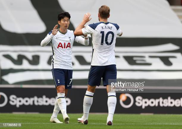 Heung-Min Son of Tottenham Hotspur celebrates with teammate Harry Kane after scoring his team's first goal during the Premier League match between...