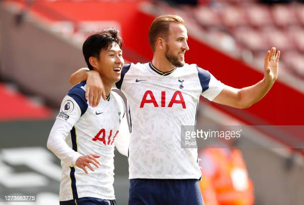 Heung-Min Son of Tottenham Hotspur celebrates with teammate Harry Kane after scoring his team's third goal during the Premier League match between...