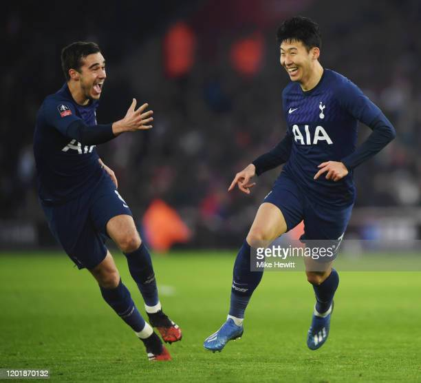 HeungMin Son of Tottenham Hotspur celebrates with teammate Harry Winks after scoring his team's first goal during the FA Cup Fourth Round match...