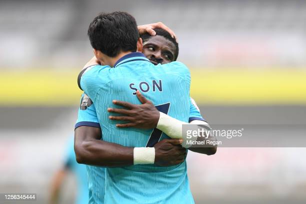 Heung-Min Son of Tottenham Hotspur celebrates with teammate Serge Aurier after scoring his sides first goal during the Premier League match between...