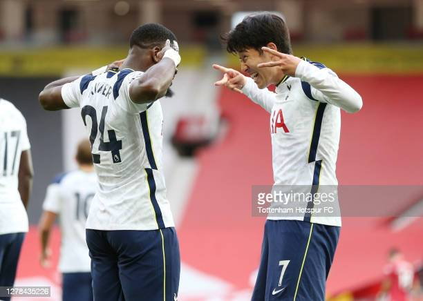 Heung-Min Son of Tottenham Hotspur celebrates with teammate Serge Aurier after scoring his sides fourth goal during the Premier League match between...
