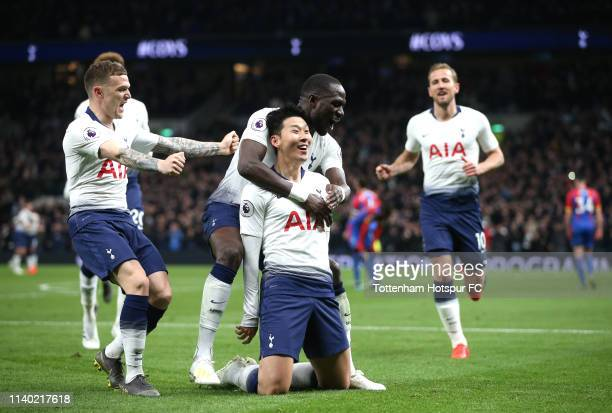 HeungMin Son of Tottenham Hotspur celebrates with teammates after scoring his team's first goal during the Premier League match between Tottenham...