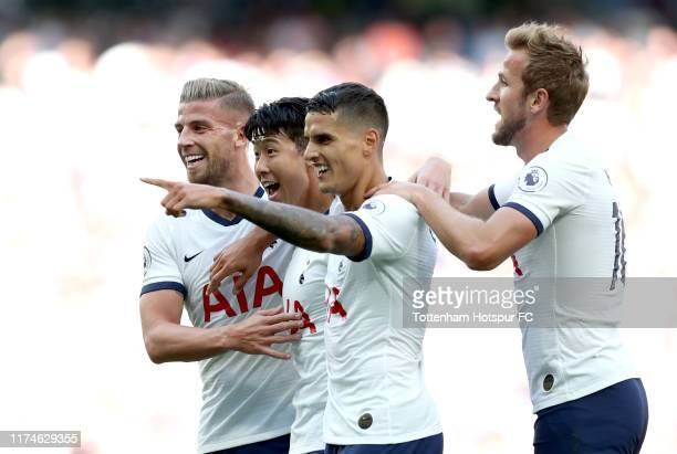 Heung-Min Son of Tottenham Hotspur celebrates with teammates after scoring his team's third goal during the Premier League match between Tottenham...