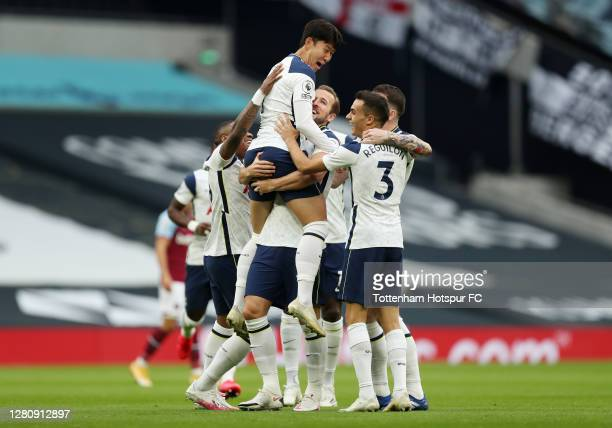 Heung-Min Son of Tottenham Hotspur celebrates with teammates after scoring his team's first goal during the Premier League match between Tottenham...