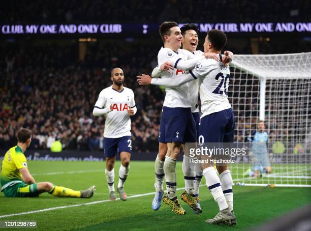 HeungMin Son of Tottenham Hotspur celebrates with teammates Giovani Lo Celso and Dele Alli after scoring his team's second goal during the Premier...