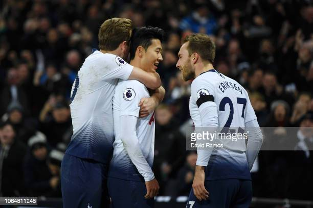 HeungMin Son of Tottenham Hotspur celebrates with teammates Harry Kane and Christian Eriksen after scoring his team's third goal during the Premier...