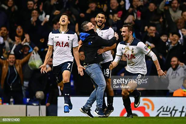HeungMin Son of Tottenham Hotspur celebrates with Vincent Janssen of Tottenham Hotspur after scoring his sides fourth goal during the Emirates FA Cup...
