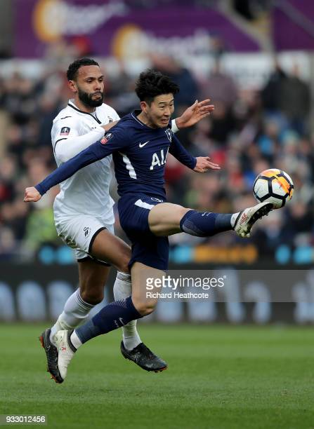 HeungMin Son of Tottenham Hotspur challenged by Kyle Bartley of Swansea City during The Emirates FA Cup Quarter Final match between Swansea City and...