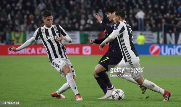 HeungMin Son of Tottenham Hotspur competes for the ball with Mattia De Sciglio and Rodrigo Bentancur of Juventus FC during the UEFA Champions League...