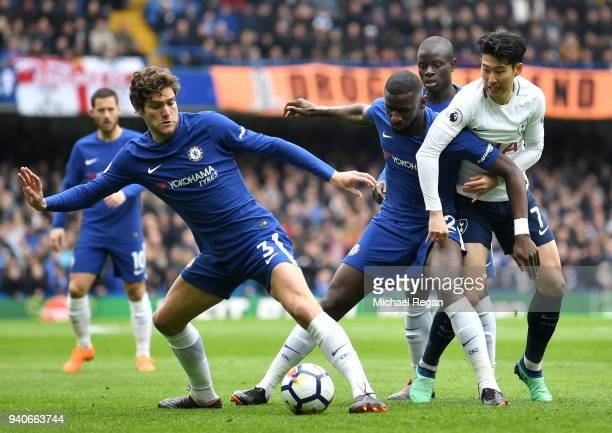 HeungMin Son of Tottenham Hotspur completes for the ball with Marcos Alonso of Chelsea Antonio Rudiger of Chelsea and N'Golo Kante of Chelsea during...