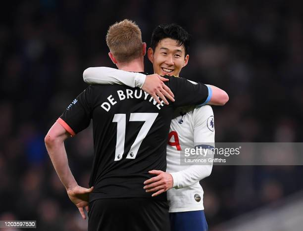 HeungMin Son of Tottenham Hotspur consoles Kevin De Bruyne of Manchester City on the final whistle during the Premier League match between Tottenham...