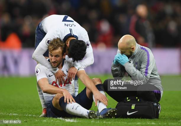 HeungMin Son of Tottenham Hotspur consoles team mates Harry Kane after the Premier League match between Tottenham Hotspur and Manchester United at...