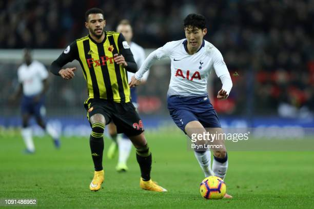 HeungMin Son of Tottenham Hotspur evades Etienne Capoue of Watford during the Premier League match between Tottenham Hotspur and Watford FC at...