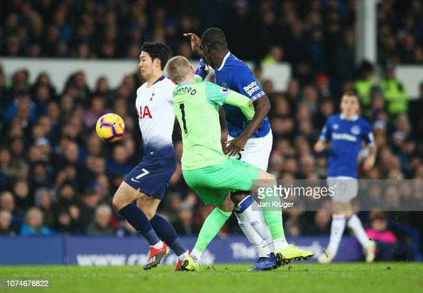 HeungMin Son of Tottenham Hotspur evades Jordan Pickford and Kurt Zouma of Everton as he scores his team's first as during the Premier League match...