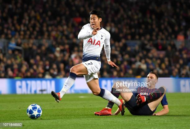 HeungMin Son of Tottenham Hotspur evades Thomas Vermaelen of Barcelona during the UEFA Champions League Group B match between FC Barcelona and...