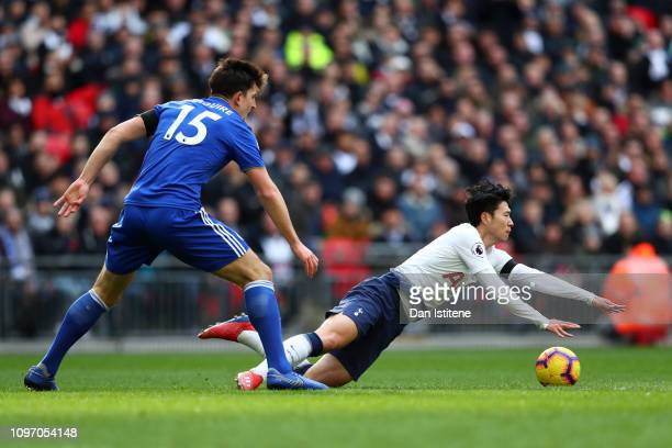 HeungMin Son of Tottenham Hotspur falls to ground under pressure from Harry Maguire of Leicester City for which he is given a yellow card for...
