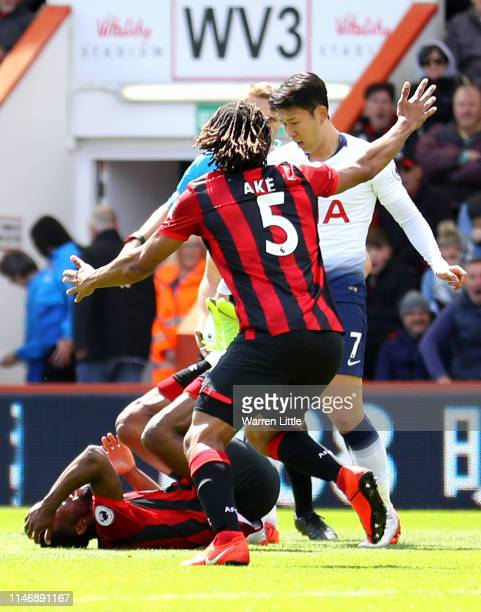 Heung-Min Son of Tottenham Hotspur fouls Jefferson Lerma of AFC Bournemouth which he later receives a red card for during the Premier League match...