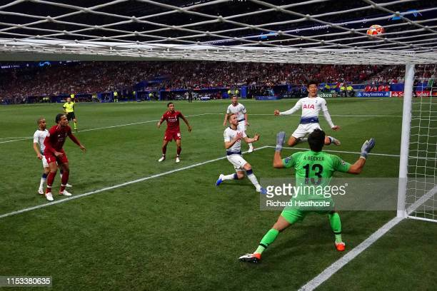 HeungMin Son of Tottenham Hotspur heads over the goal as Alisson of Liverpool looks on during the UEFA Champions League Final between Tottenham...