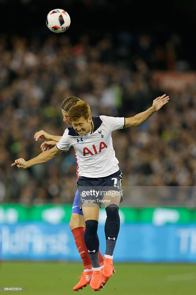 Heung-Min Son of Tottenham Hotspur heads the ball during 2016 International Champions Cup Australia match between Tottenham Hotspur and Atletico de Madrid at Melbourne Cricket Ground on July 29, 2016 in Melbourne, Australia.