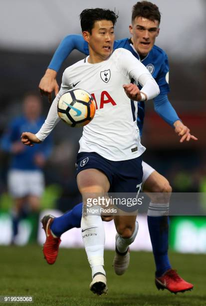 HeungMin Son of Tottenham Hotspur holds off Ryan Delaney of Rochdale AFC during The Emirates FA Cup Fifth Round match between Rochdale and Tottenham...