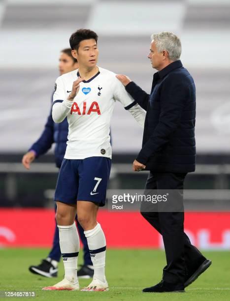 HeungMin Son of Tottenham Hotspur interacts with Jose Mourinho Manager of Tottenham Hotspur during the Premier League match between Tottenham Hotspur...