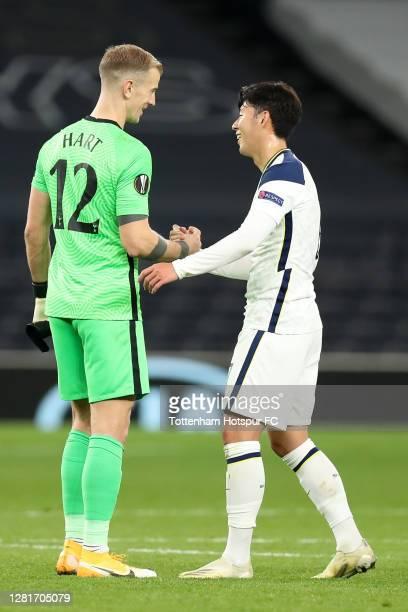 HeungMin Son of Tottenham Hotspur interacts with team mate Joe Hart following the UEFA Europa League Group J stage match between Tottenham Hotspur...