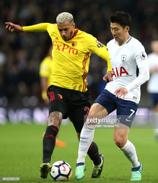 HeungMin Son of Tottenham Hotspur is challenged by Etienne Capoue of Watford during the Premier League match between Tottenham Hotspur and Watford at...