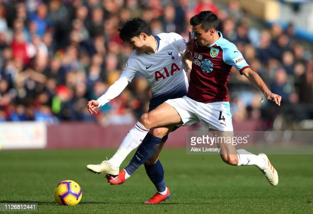 HeungMin Son of Tottenham Hotspur is challenged by Jack Cork of Burnley during the Premier League match between Burnley FC and Tottenham Hotspur at...