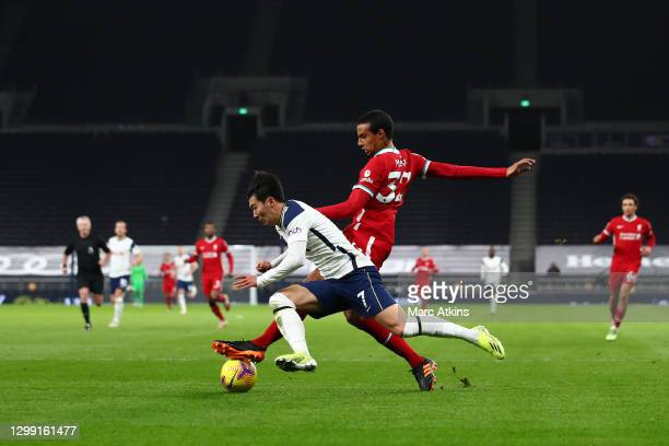 Heung-Min Son of Tottenham Hotspur is challenged by Joel Matip of Liverpool during the Premier League match between Tottenham Hotspur and Liverpool...
