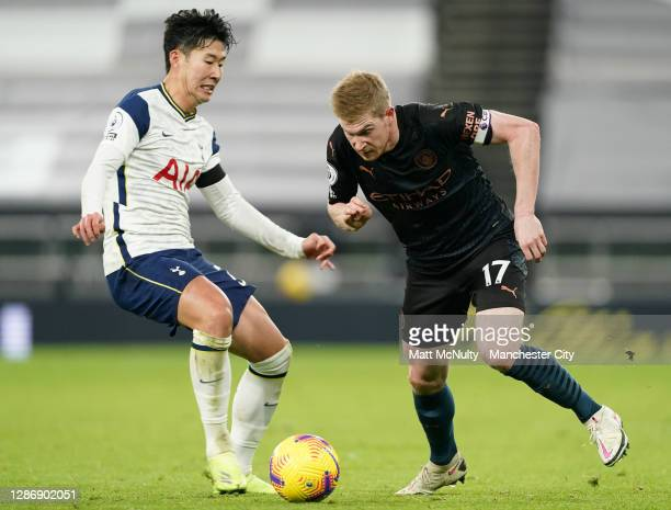 Heung-Min Son of Tottenham Hotspur is challenged by Kevin De Bruyne of Manchester Cityduring the Premier League match between Tottenham Hotspur and...