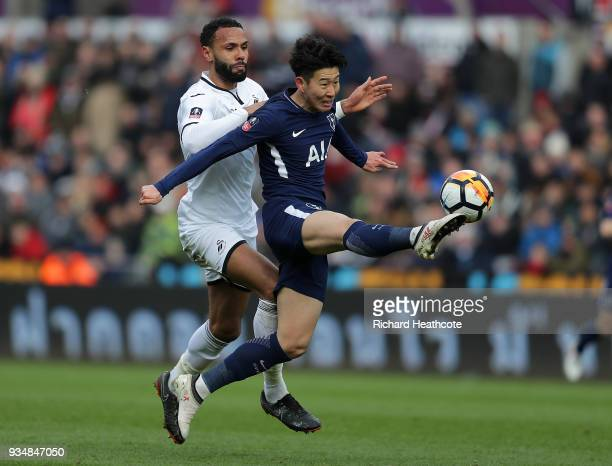 HeungMin Son of Tottenham Hotspur is challenged by Kyle Bartley of Swansea City during The Emirates FA Cup Quarter Final match between Swansea City...