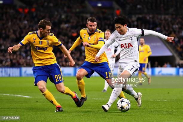 HeungMin Son of Tottenham Hotspur is challenged by Stephan Lichtsteiner and Andrea Barzagli both of Juventus during the UEFA Champions League Round...