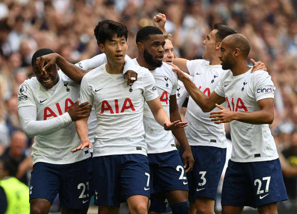 Heung-Min Son of Tottenham Hotspur is congratulated by team mates after scoring their side's first goal during the Premier League match between...