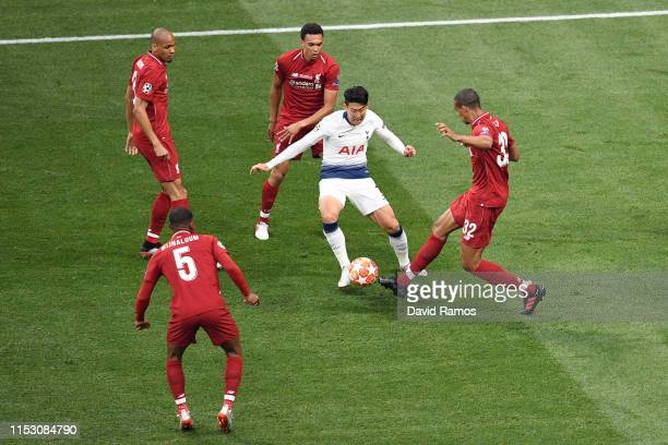 HeungMin Son of Tottenham Hotspur is crowded out by Joel Matip Trent AlexanderArnold Fabinho and Georginio Wijnaldum of Liverpool during the UEFA...
