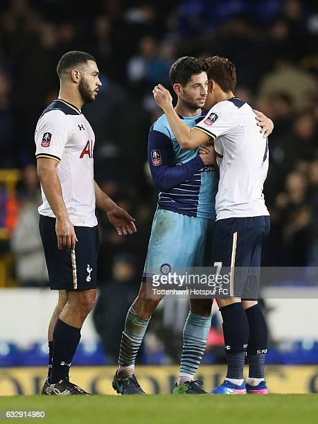 HeungMin Son of Tottenham Hotspur is embraced by Joe Jacobson of Wycombe Wanderers after the Emirates FA Cup Fourth Round match between Tottenham...