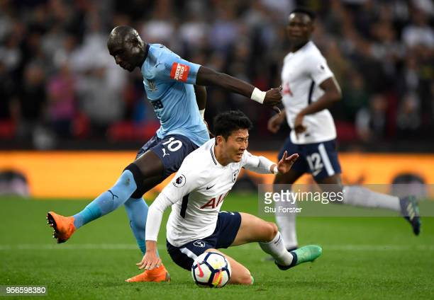 HeungMin Son of Tottenham Hotspur is fouled by Mohamed Diame of Newcastle United during the Premier League match between Tottenham Hotspur and...