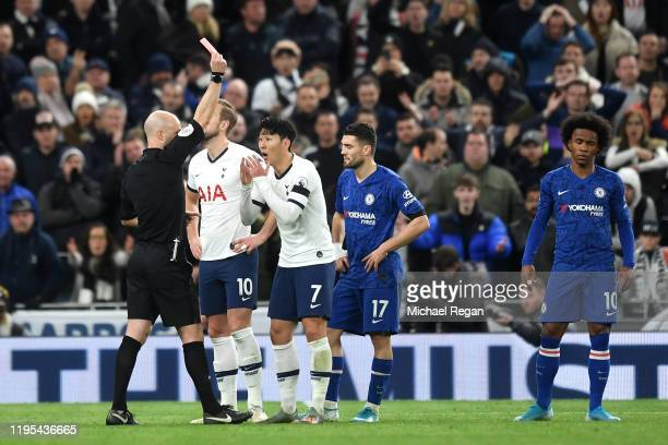 HeungMin Son of Tottenham Hotspur is shown a red card by Anthony Taylor during the Premier League match between Tottenham Hotspur and Chelsea FC at...
