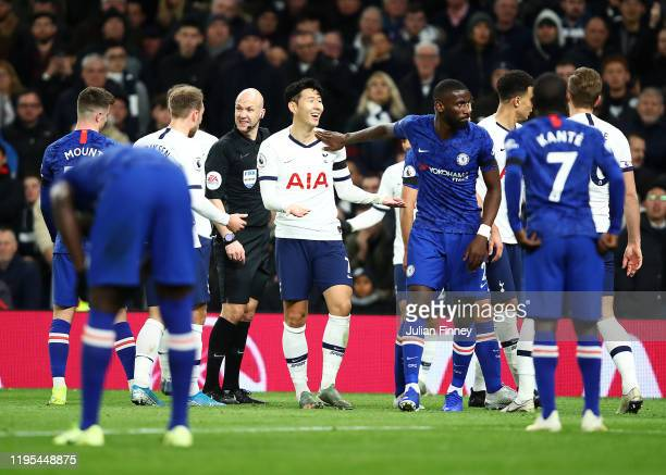 Heung-Min Son of Tottenham Hotspur is shown a red card by Anthony Taylor during the Premier League match between Tottenham Hotspur and Chelsea FC at...