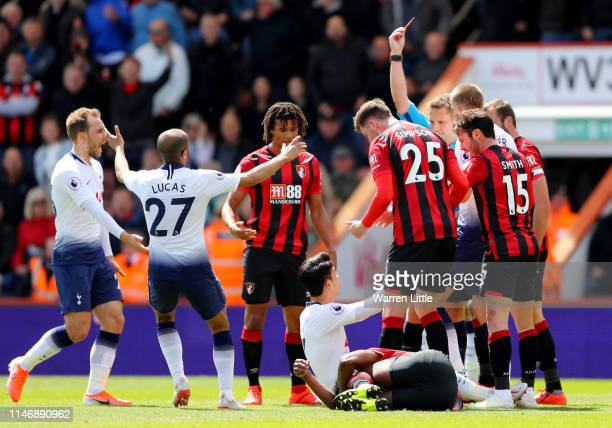 HeungMin Son of Tottenham Hotspur is shown a red card by referee Craig Pawson during the Premier League match between AFC Bournemouth and Tottenham...