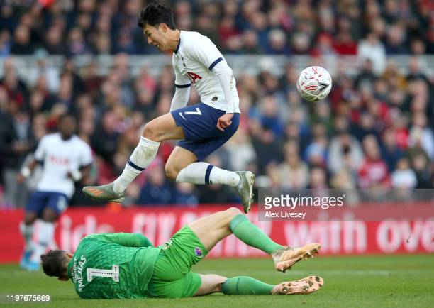 Heung-Min Son of Tottenham Hotspur jumps over a challenge from Tomas Mejias of Middlesbrough during the FA Cup Third Round match between...