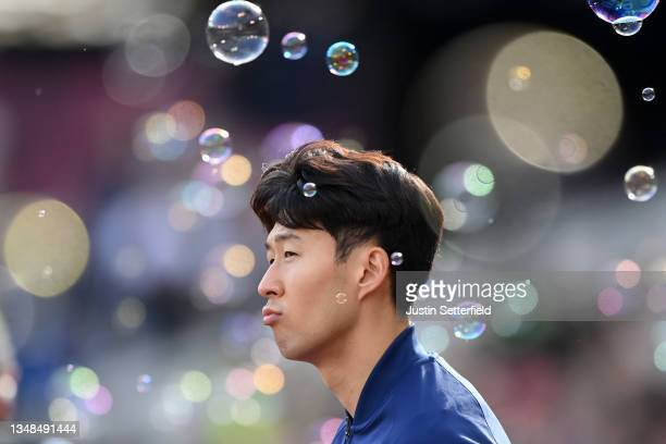 Heung-Min Son of Tottenham Hotspur looks on as he enters the pitch prior to the Premier League match between West Ham United and Tottenham Hotspur at...