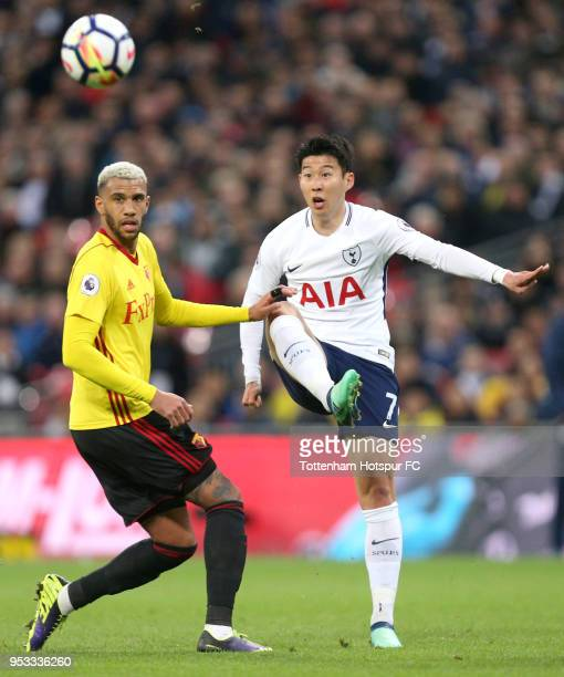 HeungMin Son of Tottenham Hotspur makes a pass while under pressure from Etienne Capoue of Watford during the Premier League match between Tottenham...