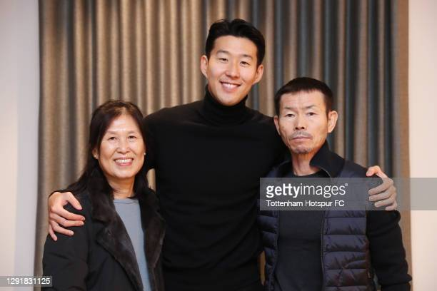 Heung-Min Son of Tottenham Hotspur poses for a photos with his parents as he wins the FIFA Puskas award at the FIFA The Best awards. The awards were...