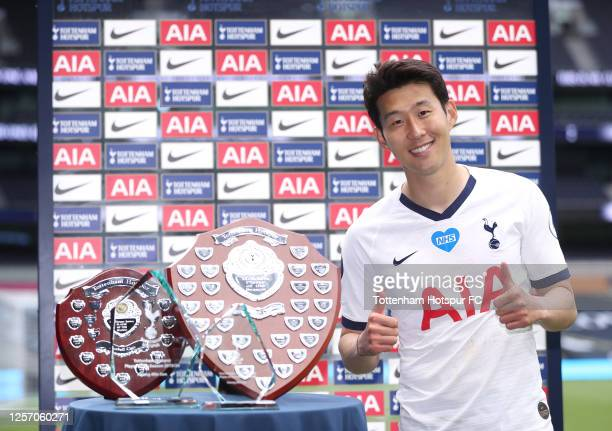 Heung-Min Son of Tottenham Hotspur poses with supporters club awards after the Premier League match between Tottenham Hotspur and Leicester City at...