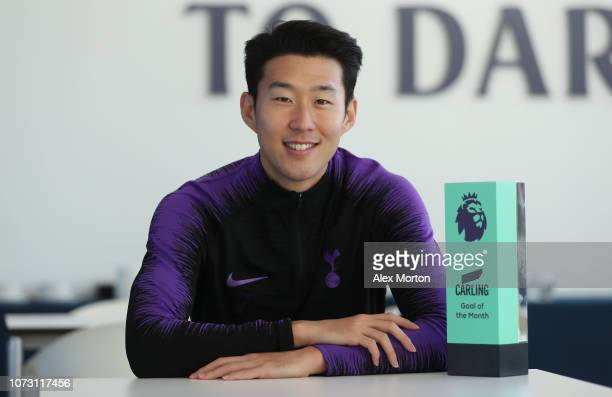 Heung-Min Son of Tottenham Hotspur poses with the Carling Premier League Goal of the Month award at Tottenham Hotspur Training Centre on December 13,...