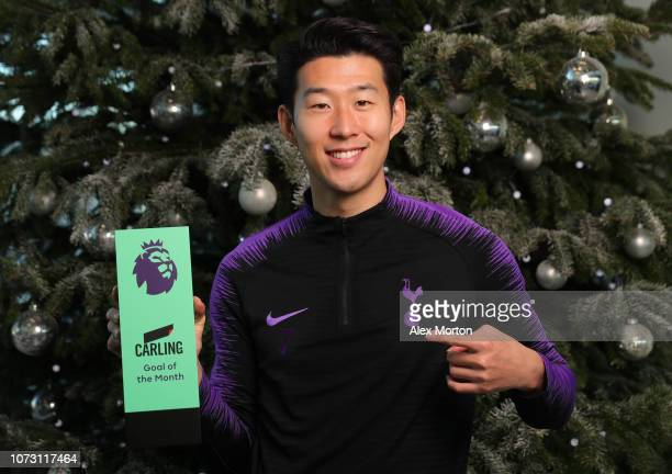 HeungMin Son of Tottenham Hotspur poses with the Carling Premier League Goal of the Month award at Tottenham Hotspur Training Centre on December 13...