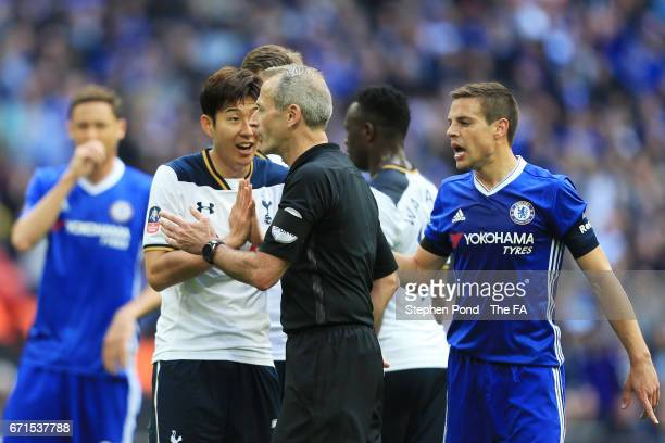 Heung-Min Son of Tottenham Hotspur protests to Martin Atkinson after a penalty is awarded to Chelsea during The Emirates FA Cup Semi-Final between...