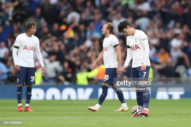 Heung-Min Son of Tottenham Hotspur reacts after their side concedes a second goal during the Premier League match between Tottenham Hotspur and...