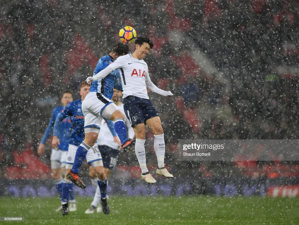 Heung-Min Son of Tottenham Hotspur rises for the ball under pressure from Harrison McGahey of Rochdale during the Emirates FA Cup Fifth Round Replay match between Tottenham Hotspur and Rochdale at Wembley Stadium on February 28, 2018 in London, United Kingdom.